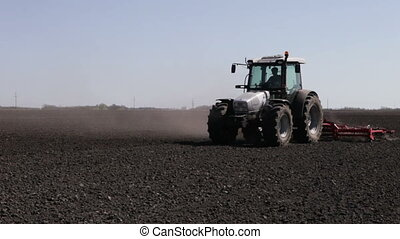 tractor plowing black field boundless - SMELA,...