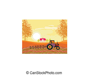 Tractor plowing field in autumn
