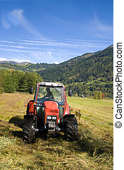 Tractor plowing field on a sunny autumn day.
