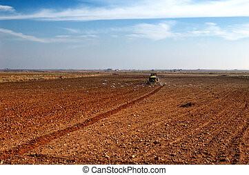 Tractor plowing in the country - Spanish countryside,...