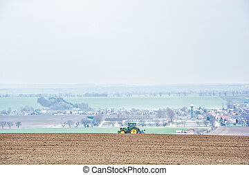 Tractor plowing on the wheat field