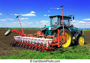 Tractor plowing the fields in early spring.