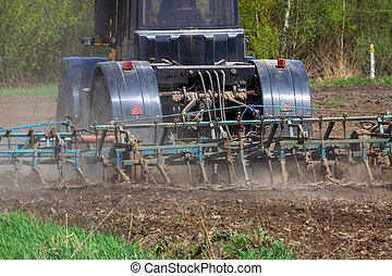 Tractor plowing - Tractor cultivating the field