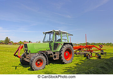 Tractor plows a field in the spring