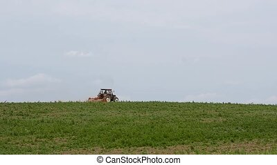 Tractor plows the field. agricultural machinery on a...