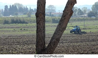 Tractor preparing the ground for sowing