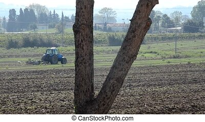 Tractor preparing the soil for sowing