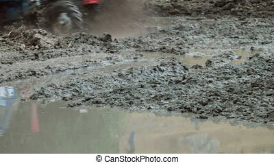 tractor race through the mud
