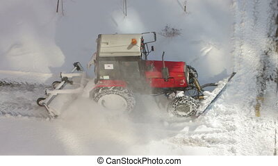 Tractor removing snow from walkways