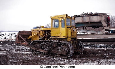 Tractor rides through mud