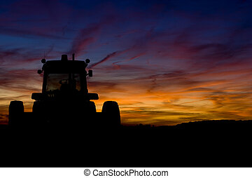 Tractor - Silhouette of a tractor at sunset