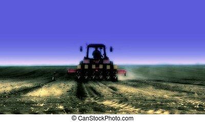 tractor sowing soya ,soya beam field