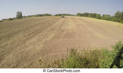 Tractor sowing, time lapse 4K - Tractor sowing in the field...