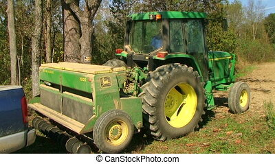 Tractor Sowing With Seeder - Tractor sowing crop with...