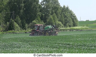 Tractor spray fertilize crop field