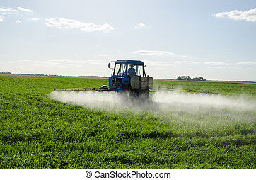 Tractor spray fertilize field pesticide chemical - Tractor...