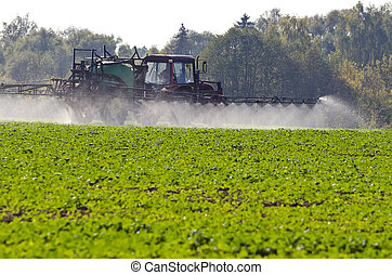 Tractor spray fertilize  with insecticide herbicide chemicals in agriculture field
