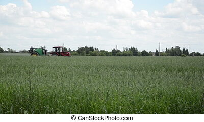 tractor spray herbicide - Tractor with agricultural...