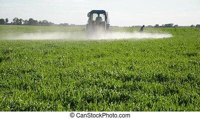 tractor spray insecticide - Tractor spray fertilize field...