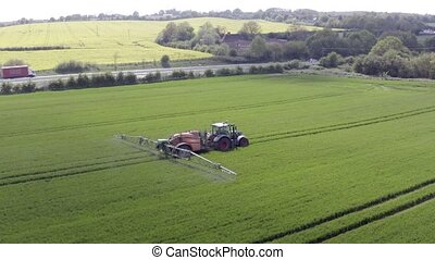 Tractor Spraying a Banned Glyphosate Herbicide on Agricultural Land