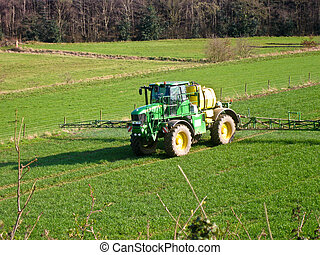 Tractor spraying