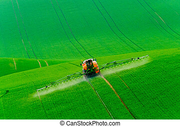 Tractor spraying the chemicals
