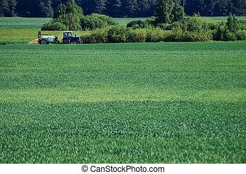 Tractor sprays water, pesticide treatment