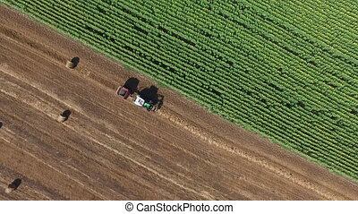 Tractor Straw Baler in an Agricultural Field - Aerial...
