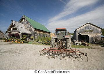 tractor tiller in front of garden center in rural vermont