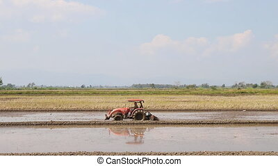 Tractor on harvest field, rural scene