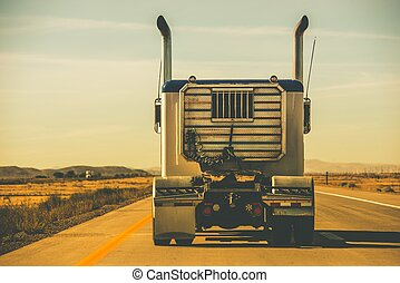 Tractor Trailer on the Highway. Trucking Theme.