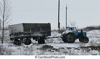Tractor trailer slips stuck in the snow on the road winter -...