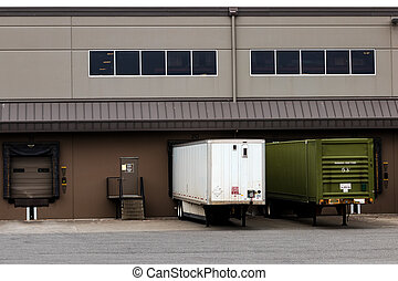 Tractor trailers at a warehouse cargo dock