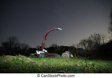 tractor under a clear starry night sky.