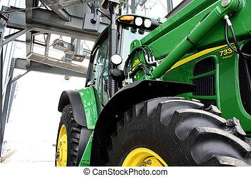 Tractor under silo - tractor parked under silo