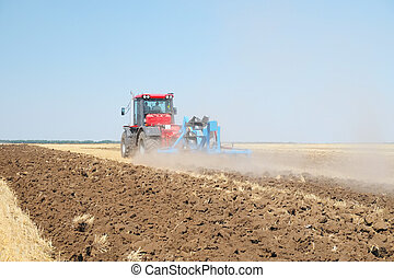 tractor with a plow