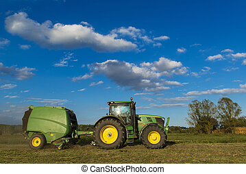 Tractor with machinery for making bales of hay - Tractor...