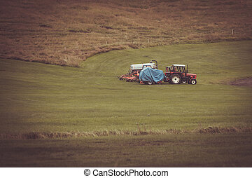 Tractor with plowes on an Iceland field