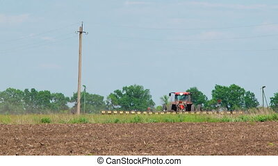 Tractor With Seeder Sowing Crops In The Field