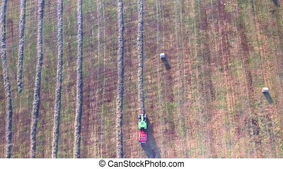 tractor working in fields aerial view - flying above tractor...