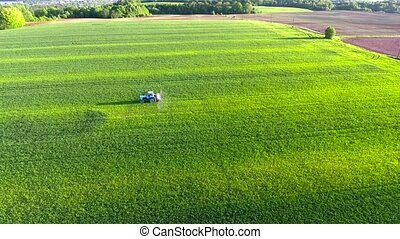 tractor working in the fields - tractor working in the green...