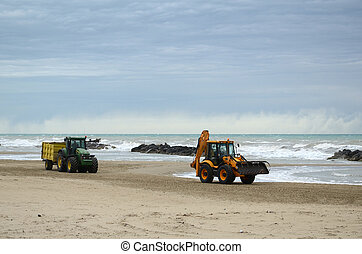 tractors on the beach