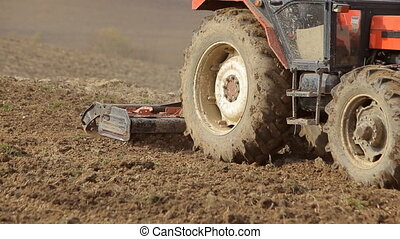 Tractors preparing land for sowing