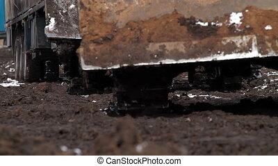 Tractors ride through mud 2