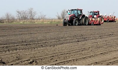 tractors sowing - tractors in the field