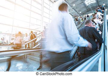 trade fair visitors using a escalator
