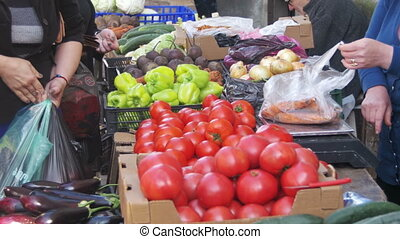 Trade, the Seller Sells Vegetables and Fruits on the Counter of the Spontaneous Market