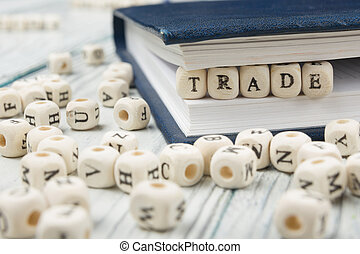 TRADE word background on wood blocks. Wooden ABC