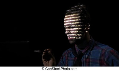 Trader using his home computer at night to access blockchain...