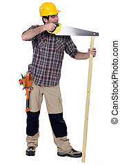 Tradesman carelessly sawing a plank of wood